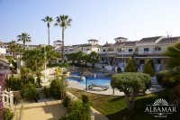 2 bed 1 bath town house on Res. Albamar a luxury gated development of apartments and townhouses with superb communal pools (0)
