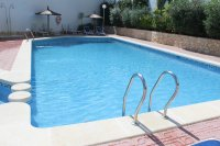 Immaculate ground floor apartment with community pool (17)