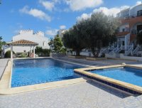 Well-presented apartment with large glazed terrace and communal pool (1)