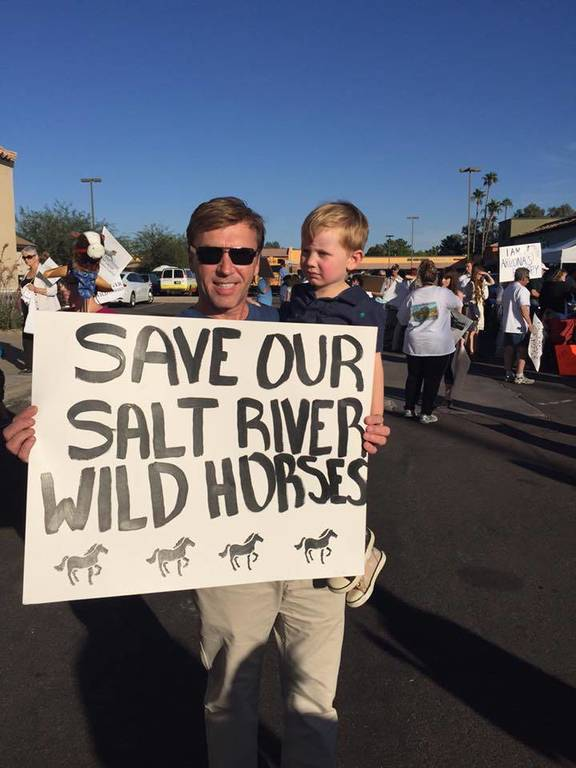 "Chase and I protesting for the ""Salt River Wild horses"""