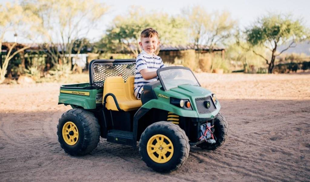 Chase and his vehicle of choice around the farm