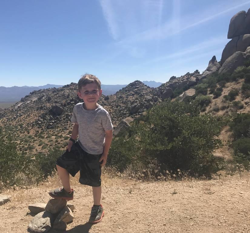 Chase hiking Tom's Thumb