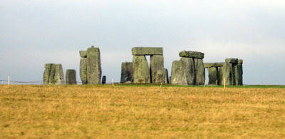 The megalithic ruin known as Stonehenge stands on the open downland of Salisbury Plain two miles west of the town of Amesbury, Wiltshire, in Southern England. It is not a single structure but consists of a series of earth, timber, and stone structures that were revised and re-modelled over a period of more than 1400 years.