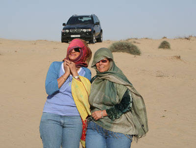 Is it Bedouin ladies or just Sigi & Darryl with the BMW stuck in the sand?