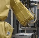 A robotic arm sprays insulating foam at the GE Appliances & Lighting refrigerator manufacturing facility in Decatur, Ala.