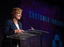Melanie Cook accepts award