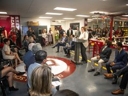 GE Appliances Chief Operating Officer Melanie Cook speaks to students and guests at Doss High School at the lauch of the Mock Assembly Line.
