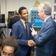 Louisville Mayor Greg Fischer greets student leader Ghadi Nshimiyimani at the launch of the Doss High School mock assembly line