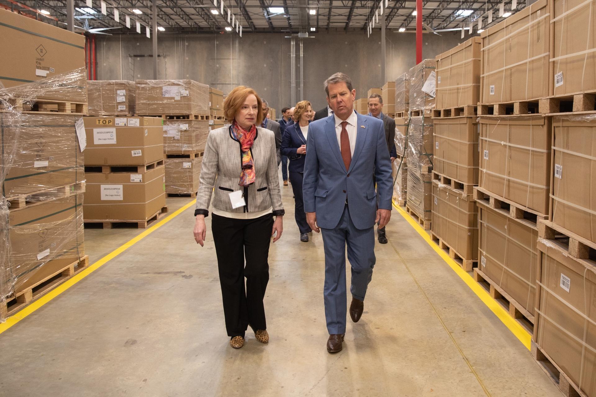 Roper Corp Executive Director Lois Crandell walks GA Gov Kemp through the Southern Logistics Center