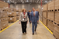 Roper Corp Executive Director Lois Crandell walks GA Gov Kemp through the Southern Logistics Center