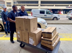 University of Louisville Health team unloads a donation of 2500 N95 masks from GE Appliances