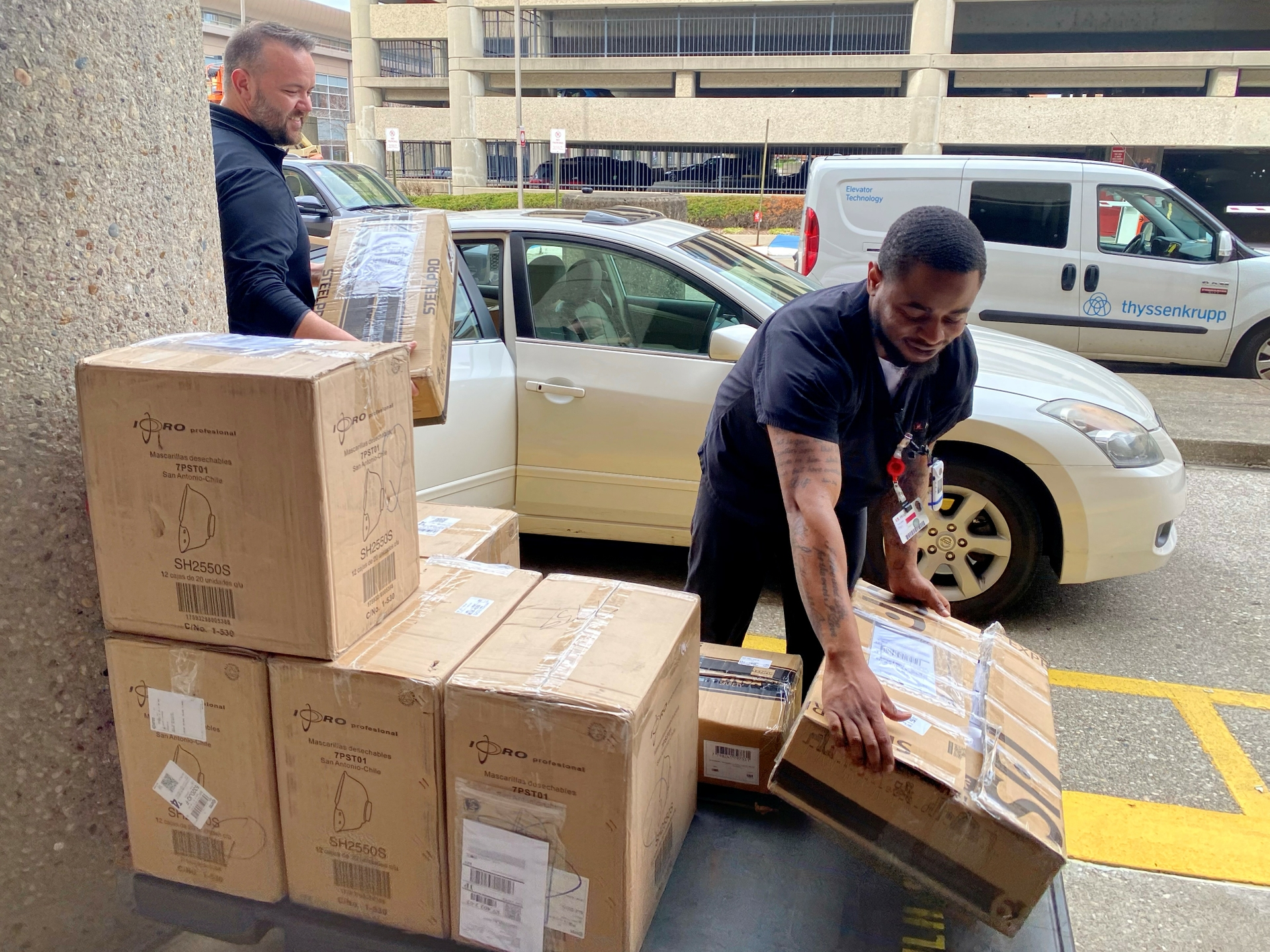 University of Louisville Health team accepts a donation of 2500 N95 masks from GE Appliances