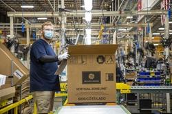 Steven Schwarmer works on the GE Zoneline® Ultimate V10™ line