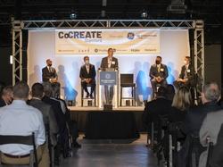 GEA CEO Kevin Nolan speaks from podium