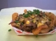 Pelican Joe's cheese fries topped with chopped brisket and chives