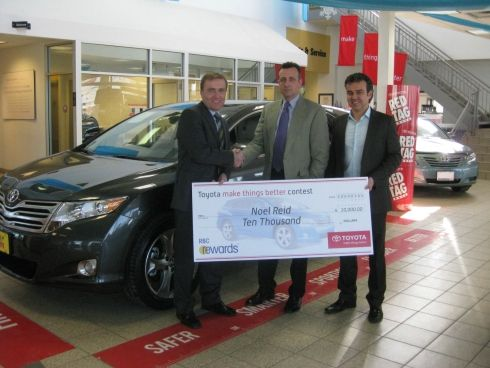 Toyota and RBC Rewards congratulate Toyota driver and winner of a $10,000 cheque in the 2008 make things better contest