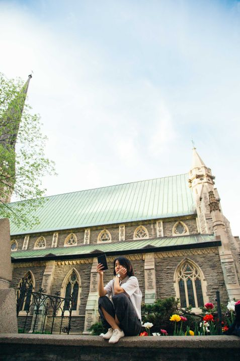 Yunjung Na sits outside a church in downtown Montreal