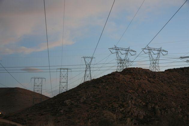 Transmission Towers Traverse Landscape