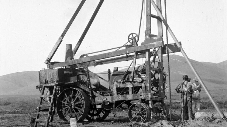 Crew stands next to well-drilling equipment in Tulare County in 1914