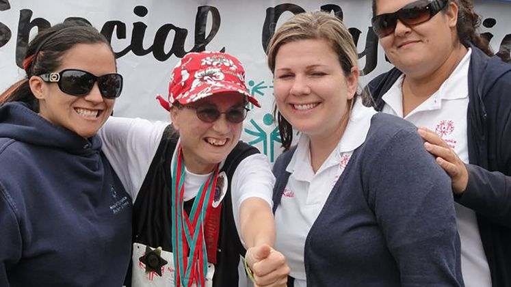 Special Olympics - Sarah with her trainers