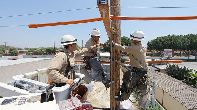 Linemen make repairs on pole