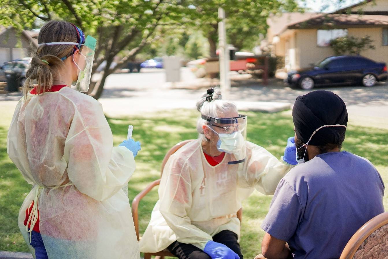 Medical Teams International volunteer test a patient at a Yakima Wash. clinic