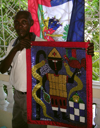Haitian artist Maxon Sylla lost his home and his wife in the earthquake. He is rebuilding his life by focusing on his work: creating traditional vodoun flags, which UCLA professor Robin Derby sells for him.