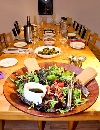 Salad and tapenade got the evening started at one of Blumstein's deliberately controversial dinners. Photo by Patty Civalleri.