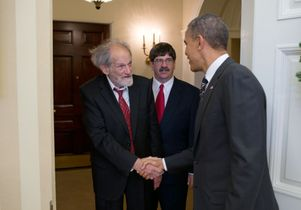 Click to open the large image: Lloyd Shapley meets President Obama