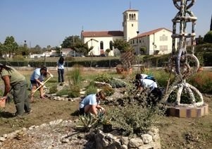 Click to open the large image: Gardening at Watts Towers