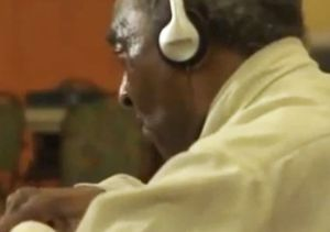 Click to open the large image: Henry listens to music 2 220 tall
