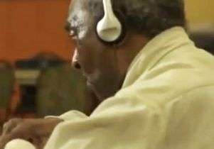Click to open the large image: Henry listens to music 2 250 tall