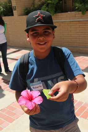 Student with flower and leaf