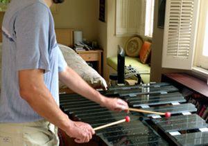 Michael Chwe plays the lithophone