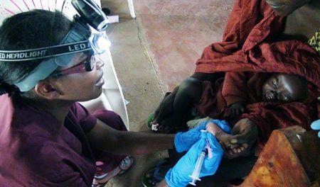 UCLA nurse Millicent Manyore treating Kenyan baby