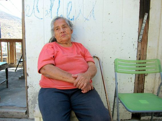 Woman sits outside Tijuana clinic