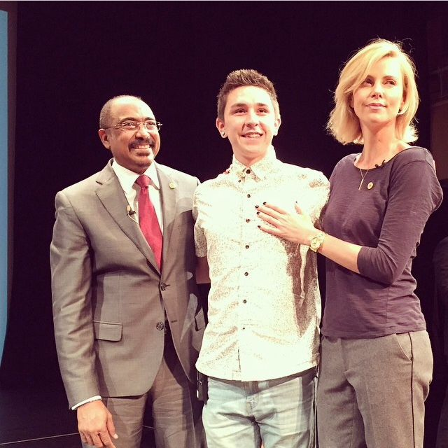 Michel Sidibé, UCLA student Zakk Marquez of the UCLA Sex Squad and Charlize Theron