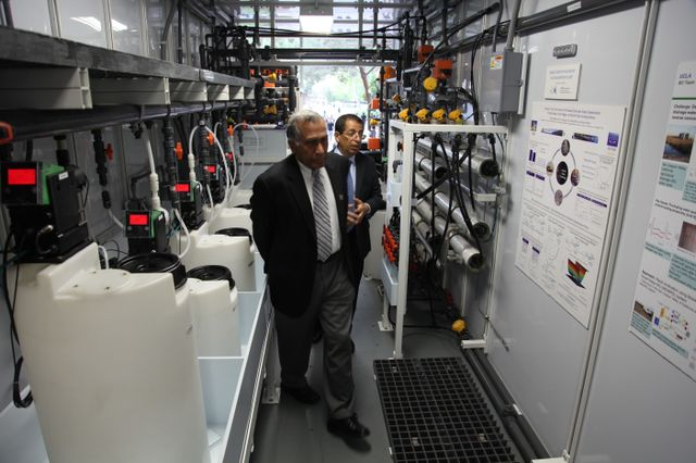 Yoram Cohen and Vijay Dhir inside mobile water treatment plant