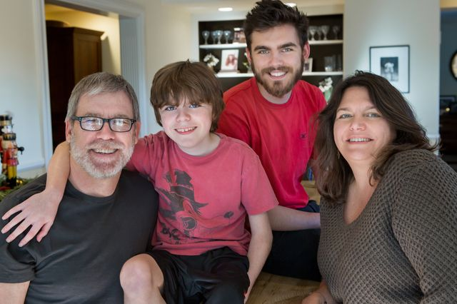 Dr. Stanley F. Nelson (from the left), sons Dylan and Calvin Miceli-Nelson, and M. Carrie Miceli