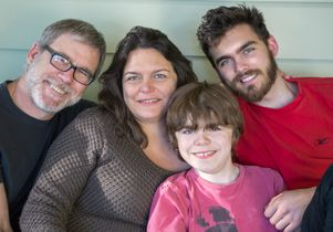Dr. Stanley F. Nelson (from the left), M. Carrie Miceli and sons Dylan and Calvin Miceli-Nelson