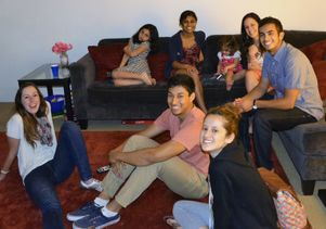 Students at Neil Garg's home, along with his daughters
