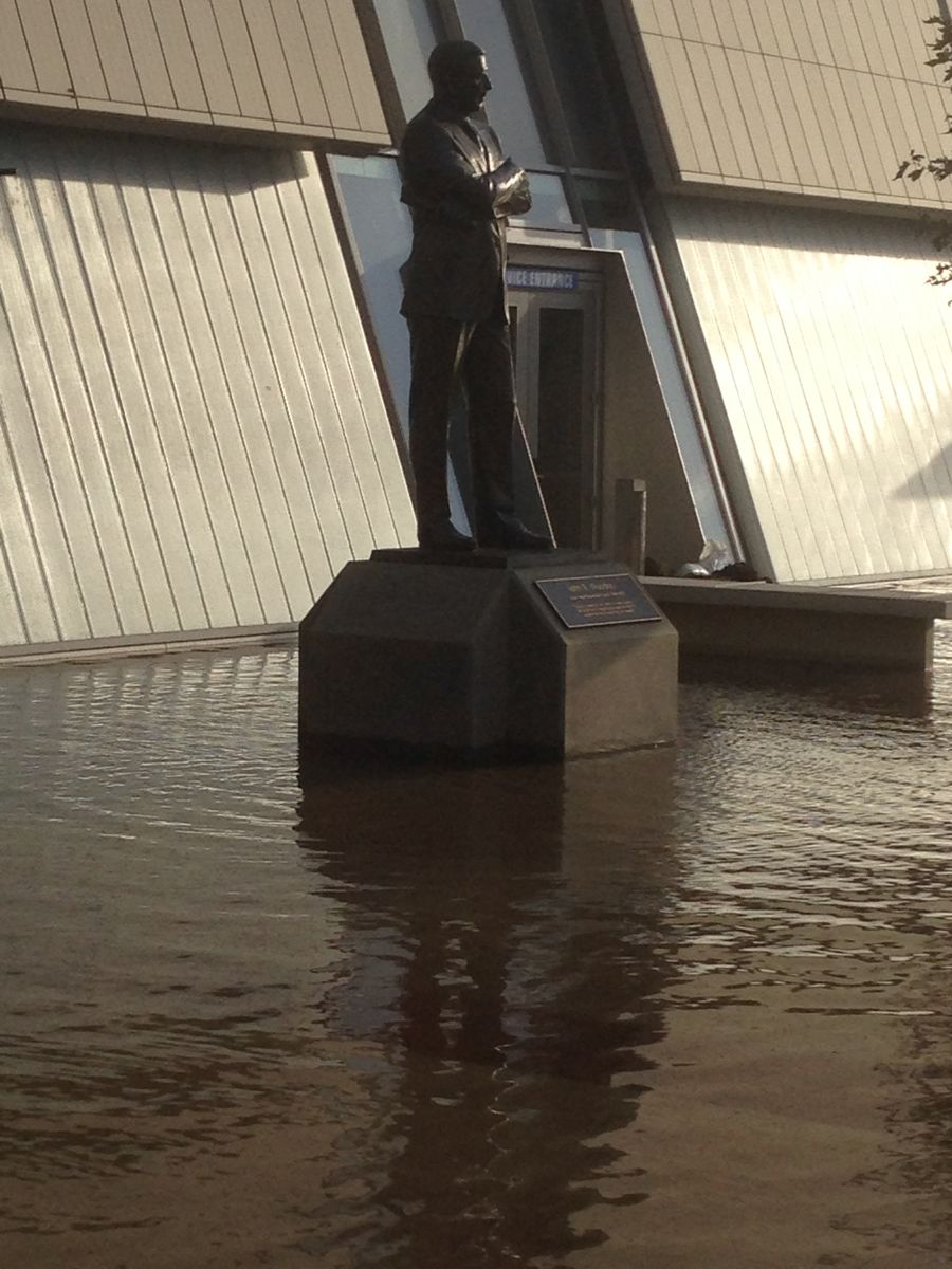 John Wooden statue flooded