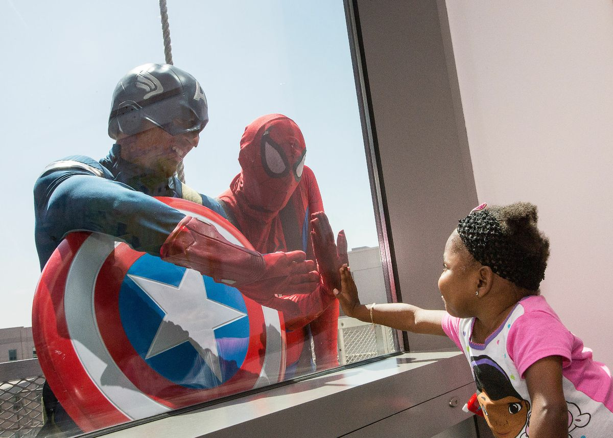 Superhero window washers and Erin
