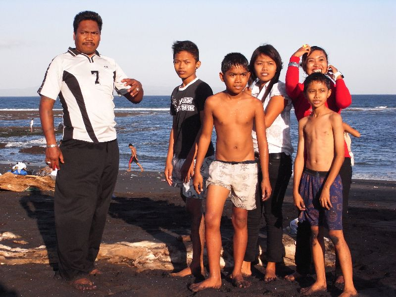 A father and his children in Bali