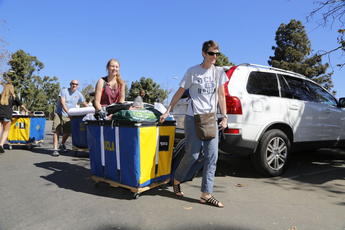 Families push carts to help move students in