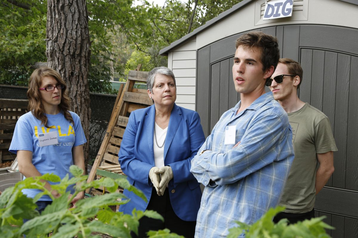 UC President Janet Napolitano and gardening students