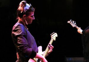 Click to open the large image: Jessica Schwartz with guitar