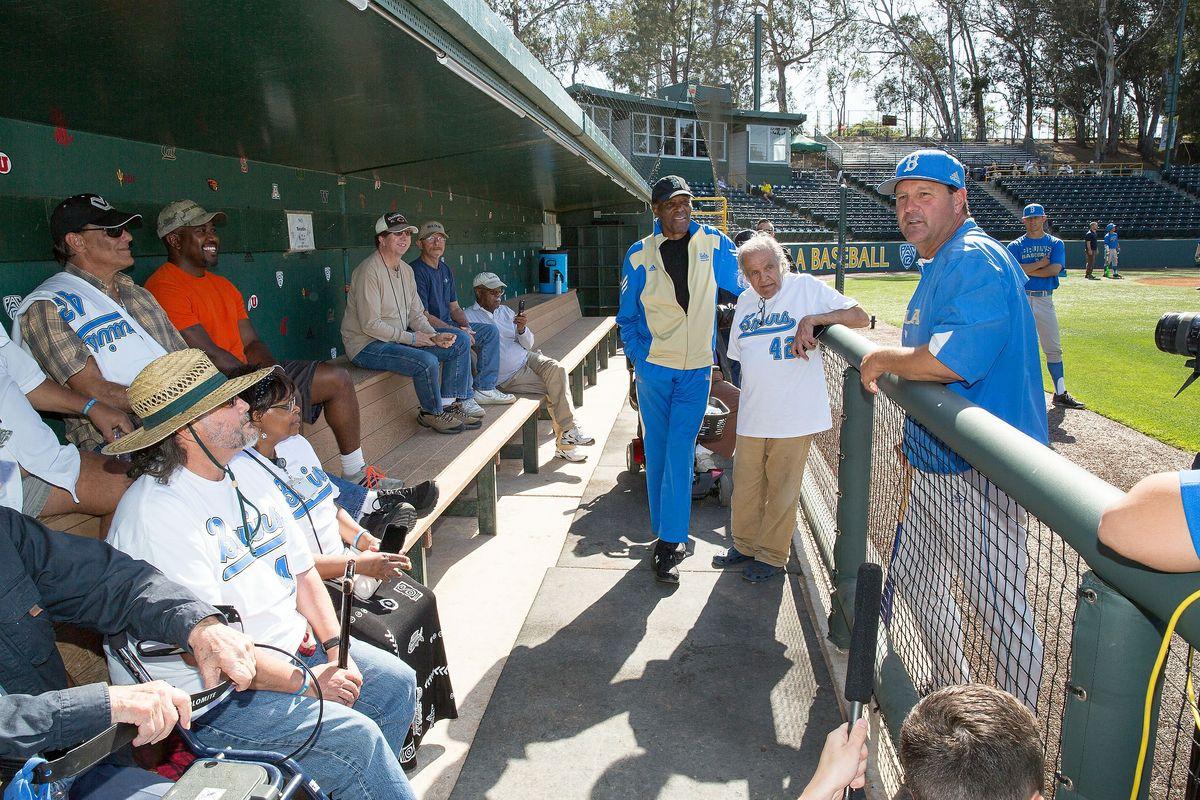 Head baseball coach John Savage talks to veterans