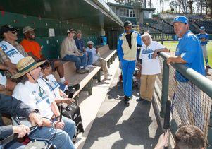 Click to open the large image: Head baseball coach John Savage talks to veterans