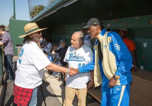 Click to open the large image: Veteran David Rivas meets Rafer Johnson and Nick Mastromatteo